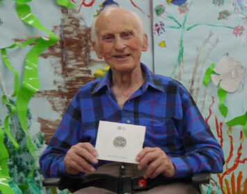 Peter Hawkins with his commemorative Royal Mint Coin August 2020