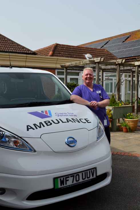 Healthcare Assistant, Lee Brace, with the new electric-powered ambulance
