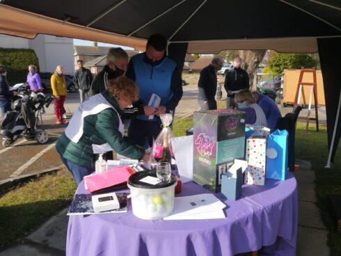 Volunteer helps with raffle
